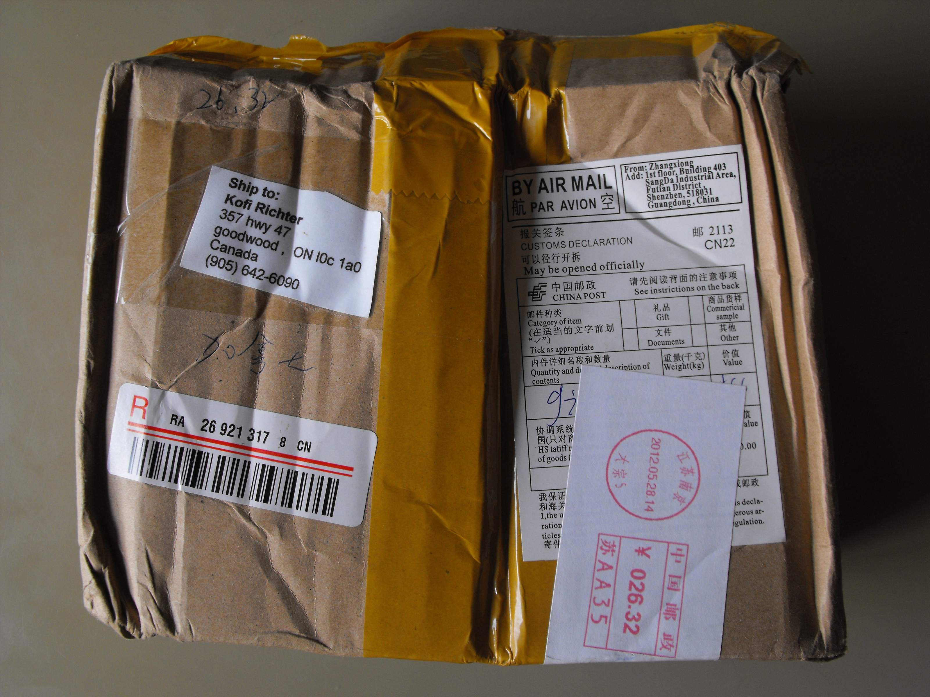 Whats wrong with canada post unfair rates front of package with registered mail tracking bar code customs form with a declared value of usd 400 and affixed postage of 2632 chinese yuan click on aloadofball Gallery